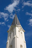 Church clock tower. Protestant church clock tower in blue sky Stock Images