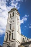 Church. Clock tower on day light Royalty Free Stock Photos