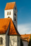 Church clock tower with red tiled roof Stock Images