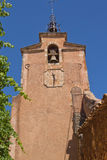 The church clock tower. (Roussillon, France) Royalty Free Stock Image