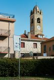 Church clock tower on street in Italy. Church clock tower on the street in Arenzzano, Italy Royalty Free Stock Image