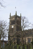 Church clock tower UK. Close up of a typical English church clock tower with graveyard Royalty Free Stock Photos