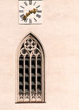 Church clock and window Stock Images