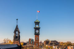 Church and Clocktower with Canadian Flag - Toronto, Ontario, Canada Royalty Free Stock Photo