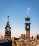 Church and Clocktower with Canadian Flag - Toronto, Ontario, Canada Royalty Free Stock Images