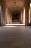 Church cloister. Sun and pendant illuminated, church cloister and access to side entry stock image