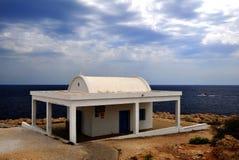 Church on the coast before the storm. Church on the Mediterranean coast of Cyprus Stock Photos