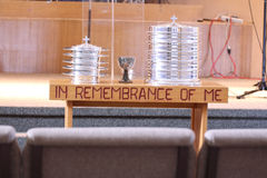 Church communion prepared table up front. The communion table prepared with wine cups before church service royalty free stock photos