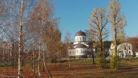 Church complex of the Exaltation of the Holy Cross. Autumn trees against the blue sky. stock video footage