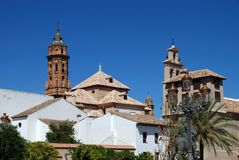 Church and convent, Antequera, Andalusia, Spain. San Sebastian church tower and Encarnation convent centre seen from the Plaza Guerrero Munoz, Antequera, Malaga Stock Image