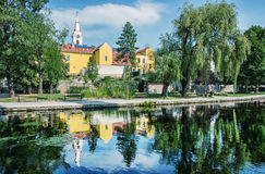 Church and convent in Tapolca is mirroring in the water level of Royalty Free Stock Photo