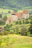 Church of Copsa Mare, Transylvania, Romania. View from surrounding hills of the fortified church of Saxon village Copsa Mare in rural Transylvania, Romania Stock Photos