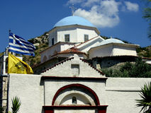 Church and Country. Church and flag in Greece Stock Images