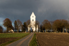 Church in the country. Dark Clouds coming up over a small Church in the countryside in Southern Sweden Royalty Free Stock Photo