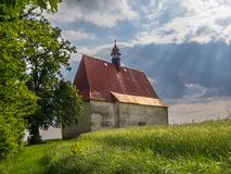 Church in the country. A small church in a rural landscape Stock Photos