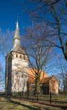 Church in countryside. Scenic view of picturesque church in countryside with blue sky background Royalty Free Stock Image
