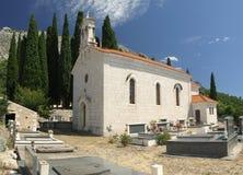 Church in croatian graveyard Royalty Free Stock Images