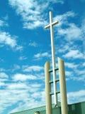 Church cross. A Christian cross on the outside of a church stock photo