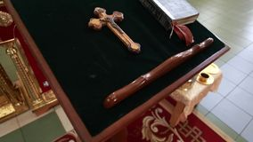 Church cross and bible in church stock footage