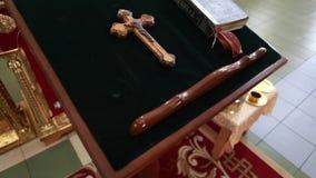Church cross and bible in church. Ukraine stock footage