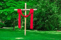 Church cross draped red clothes Royalty Free Stock Image