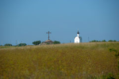 Church and cross in the open field Stock Photo