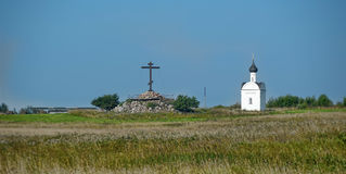Church and cross in the open field Royalty Free Stock Images