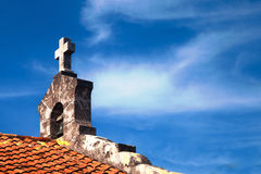 Church cross over bright blue sky. Santa Elvira, Varadero, Cuba Stock Image