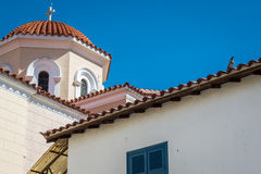 Church, cross, pigeon and blue sky Stock Image