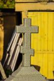 Church cross on a tombstone stock photo