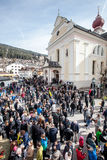 Church and crowd of faithful. Easter in Ortisei, Italy. Stock Images