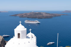 Church and cruise boat in Santorini Royalty Free Stock Photography