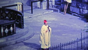 1969: Church cult practicing religion outdoor on cool morning. stock video