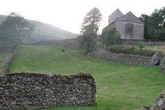 Church. In Cumbrian valley with tradtional walling style Royalty Free Stock Photos