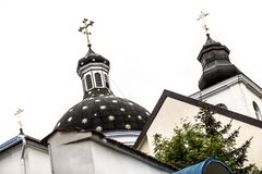 Church cupola and roof. Church black cupola and roof with golden decorations Stock Photos