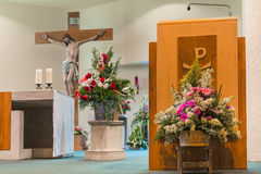 Church Decorated for a Wedding. Interior of a church decorated for with fowers a wedding ceremony Royalty Free Stock Image
