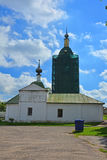 Church of the Deposition of the Robe on river Mzhar and Znamensky belltower in the centre of Suzdal, Russia Royalty Free Stock Photography
