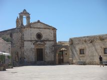 Church desecrated in Regina Margherita plaza of Marzameni in Sicily, Italy. Clear blue sky. Sunny day. Travel destination. Summertime. Hot day. People around stock images