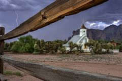 Church in the Desert. A small chapel at the base of the legendary Superstition Mountains. Prepares for a lightning storm Stock Photos