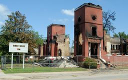 Church destroyed in fire. An old church in Georgia, USA, destroyed by fire, sign still showing the time of the Sunday service stock image