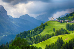 Church in Dolomites alps countryside meadow mountain Stock Images