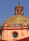 Church dome. View of a pink ornate church dome with peeling paint Royalty Free Stock Images