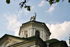 Church dome with an angel  in the the blue sky  background Royalty Free Stock Photography
