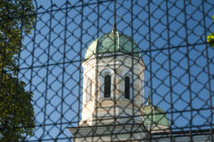 Church dome behind metal fence Stock Photos