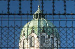Church dome behind metal fence Royalty Free Stock Photos