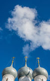 The Church dome. Church domes with crosses on a bright background of blue sky Stock Photos