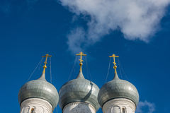 The Church dome. Church domes with crosses on a bright background of blue sky royalty free stock photography