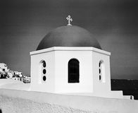 Church Dome In Oia. The dome of one of the churches in Oia on the island of Santorini in the Aegean Sea.  (Scanned from black and white film Stock Photos