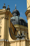 Church dome and statues in Munich, Germany. Church dome, cross and statues in Munich, Germany with deep blue sky in the background royalty free stock photos