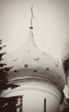 Church Dome in Trinity Sergius Lavra desocated by stars. Stock Photos